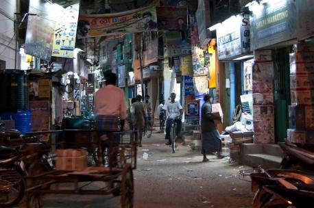 A cycle-rickshaw managing its way