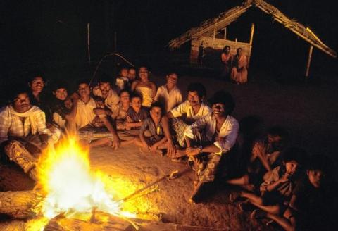 Villagers around a bonfire